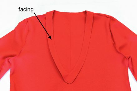 Neckline facing
